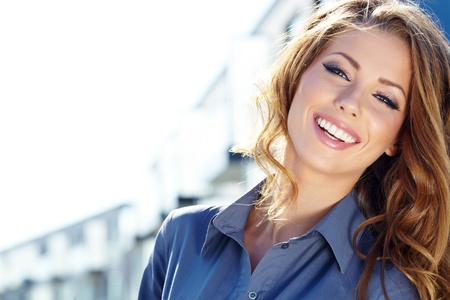 smiling: Young happy women or student on the property business background