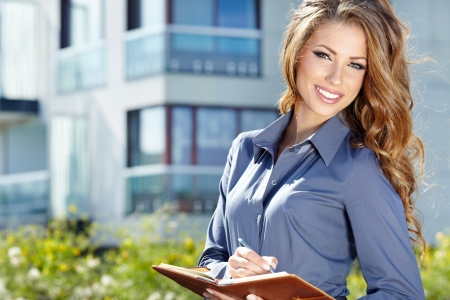 bussines: Young happy women or student on the property business background
