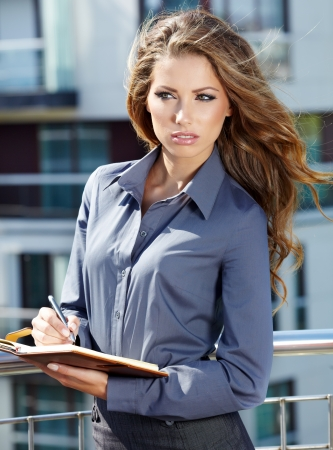 Young happy women or student on the property business background  photo
