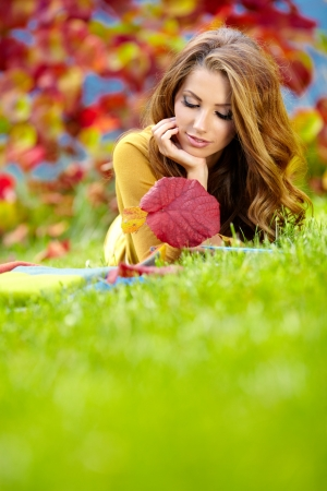 beautiful girl with book in the autumn park Stock Photo - 16333406