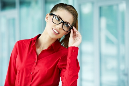 business woman in modern glass interior Stock Photo - 16333405