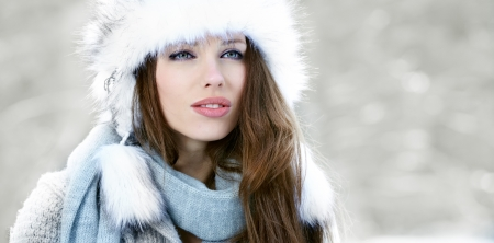 beautiful woman in warm clothing with snow  photo