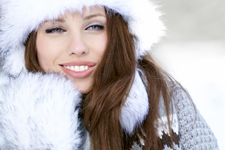 Snow winter woman portrait outdoors on snowy white winter day   photo