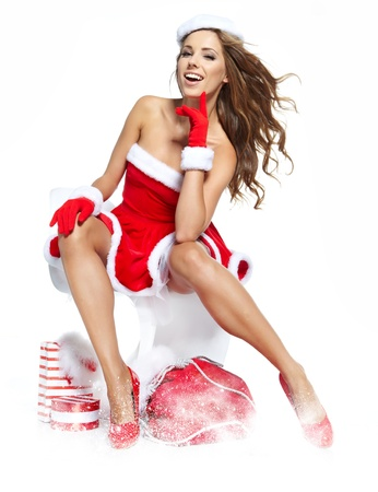 Portrait of a beautiful woman wearing a santa costume photo