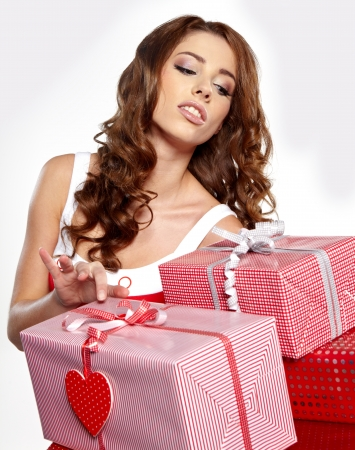 Beautiful brunette woman with a gift boxes  Stock Photo - 16491110