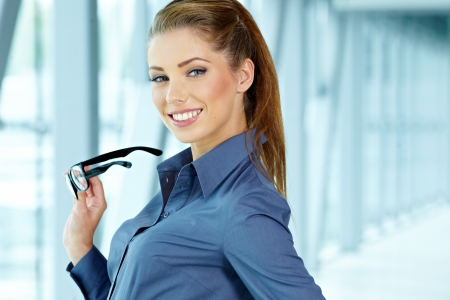 confident consultant: business woman in modern glass interior