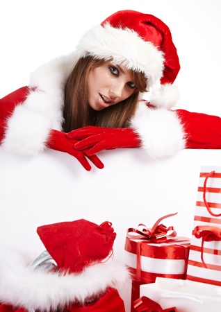 Beautiful young woman in Santa Claus clothes  Stock Photo - 16515040