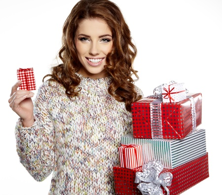 sexy girl smiles and holding a gift in magic packing Stock Photo - 16551787