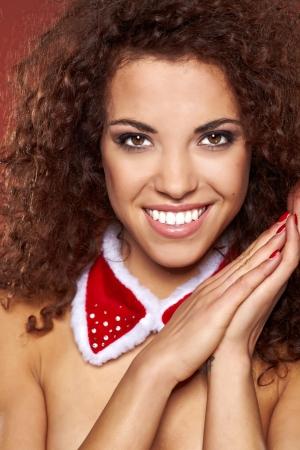 Beautiful african woman celebrating christmas photo
