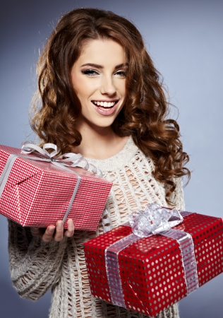 Beautiful brunette woman with a gift boxes  Stock Photo - 16614418