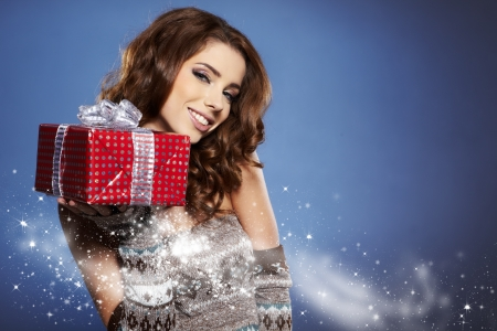 Beautiful brunette woman with a gift boxes Stock Photo - 16614420