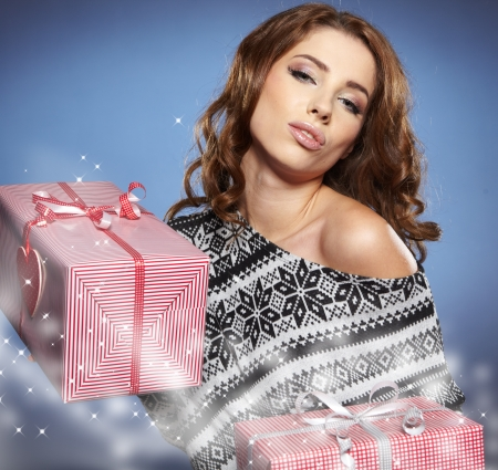 sexy birthday: sexy girl smiles and holding a gift in magic packing  Stock Photo