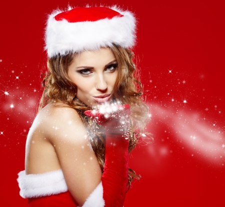 cloath: Portrait of beautiful sexy girl wearing santa claus clothes on red background