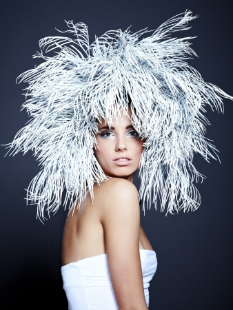 Young woman in creative image with silver artistic make-up.  photo