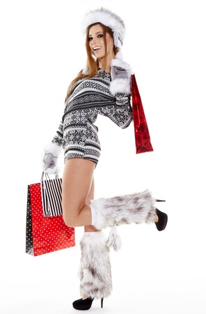Winter woman with shopping bags over white  photo