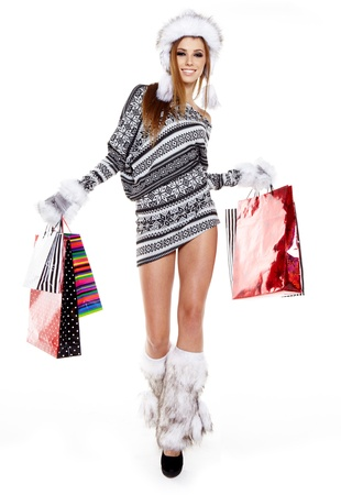 Winter woman with shopping bags over white Stock Photo - 16761762