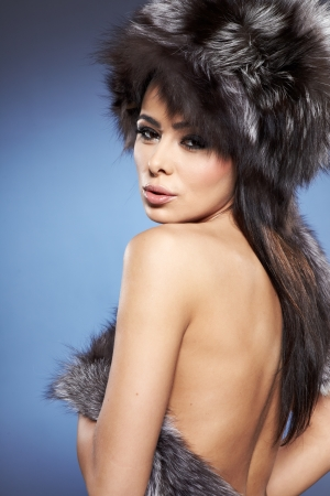 portrait of stylish woman in fur against blue background  Stock Photo - 16716008