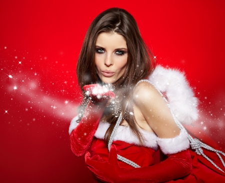 Portrait of beautiful sexy girl wearing santa claus clothes Stock Photo - 16732289