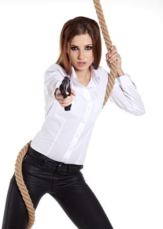 gangster girl: Sexy girl holding a black gun