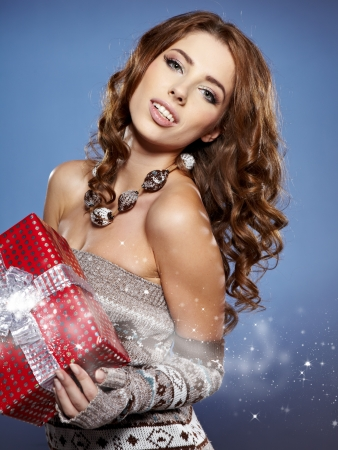 Beautiful brunette woman with a gift boxes  photo