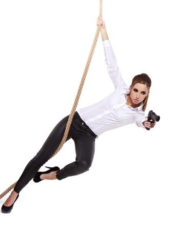 mujer con arma: Sexy chica con una pistola negro Foto de archivo