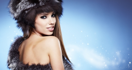 portrait of a beautiful lady in fur cap  photo