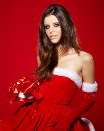 Portrait of beautiful sexy girl wearing santa claus clothes Stock Photo - 16854771