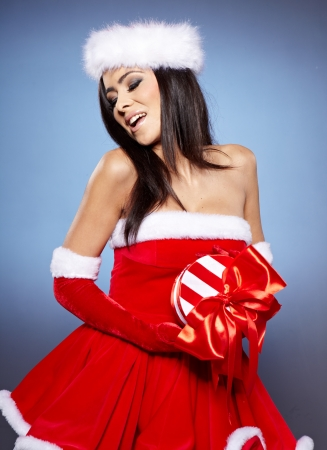 beautiful sexy girl wearing santa claus clothes with christmas gift Stock Photo - 16827178