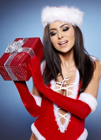red gloves: beautiful sexy girl wearing santa claus clothes with christmas gift