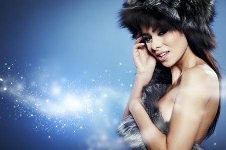 Fur Fashion  Beautiful Girl in Fur Hat  Winter Woman Portrait  Stock Photo - 16827186