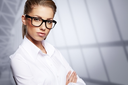 Attractive business woman smiling against  copy space background Stock Photo - 16933475