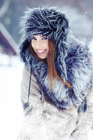 Snow winter woman portrait outdoors on snowy white winter day   Stock Photo - 17056267