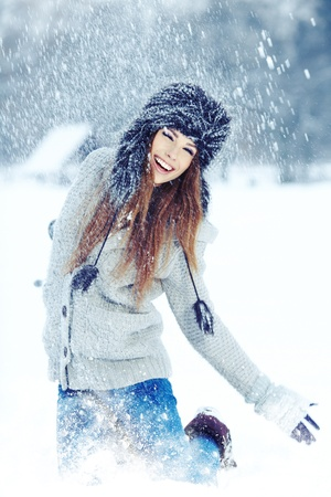 Girl playing with snow in park Stock Photo - 17104824