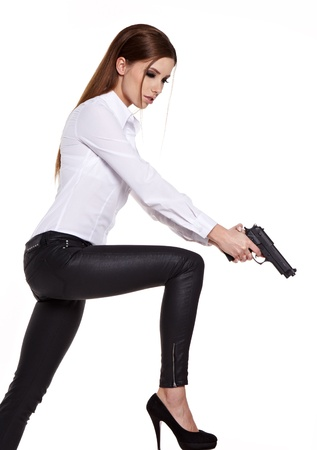 young beauty woman holding  handgun, ready to fight  photo