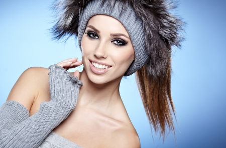 beautiful woman in warm clothing on blue background Stock Photo - 17130076