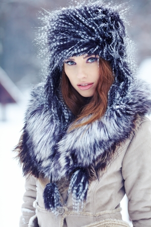 Young woman winter portrait  Shallow dof Stock Photo - 17130087