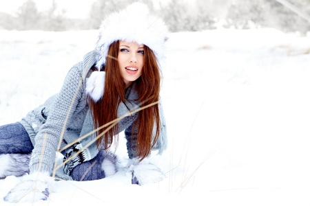 Attractive young woman in wintertime outdoor  Stock Photo - 17104817