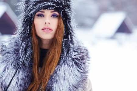 beautiful girl in winter park  Stock Photo - 17255328