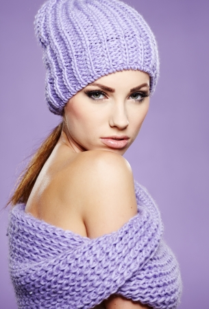 young woman wearing a winter cap photo