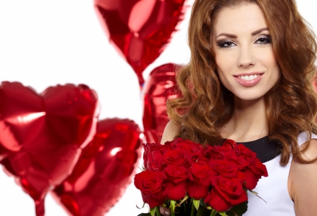 young beautiful woman smelling a bunch of red roses  photo