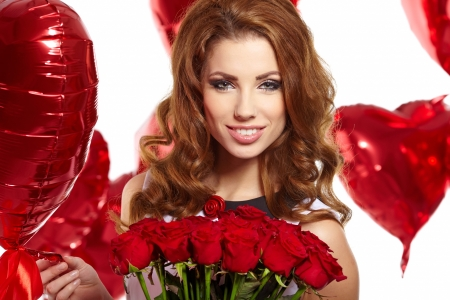 young beautiful woman smelling a bunch of red roses  Stock Photo - 17255321