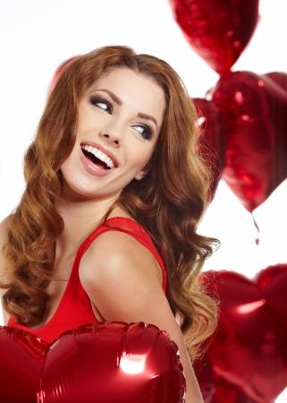 heart balloon: woman with red heart balloon  Stock Photo