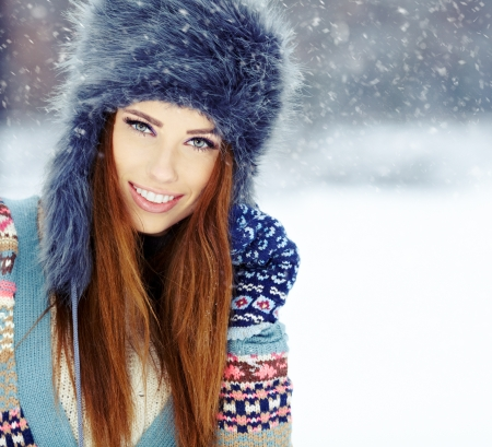 Attractive young woman in wintertime outdoor  photo