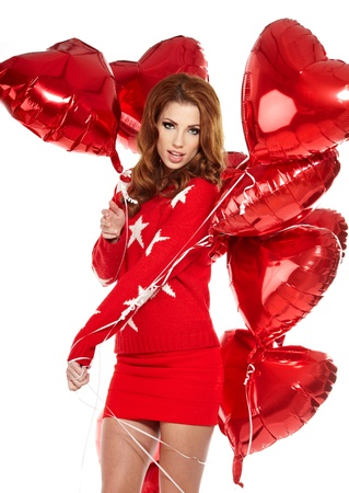 beautiful girl with red balloons hearts  photo