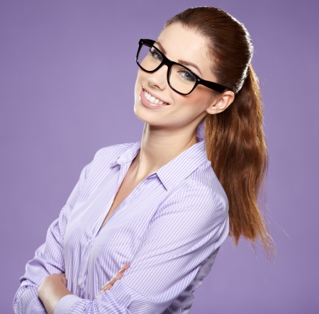 out of office: Portrait of happy smiling business woman in glasses