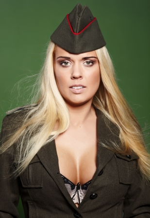 Beautiful woman  in military clothes  photo