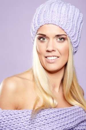 Blonde woman wearing a winter cap  photo