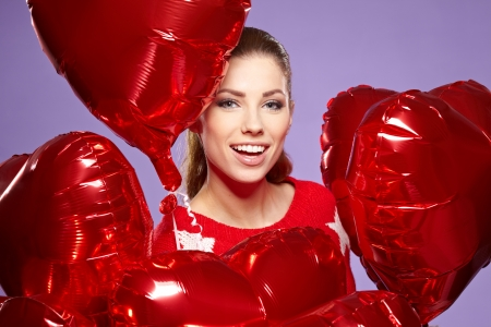 woman with red heart balloon Stock Photo - 17342818