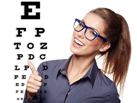 beautiful  woman with blue trendy glasses on the background of eye test chart  photo