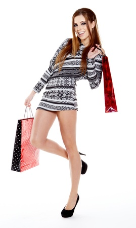 Winter woman with shopping bags over grey Stock Photo - 17277417